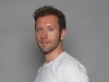 TJ Thyne models the Well-Ness Tee