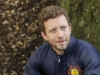 "BONES:  Hodgins (TJ Thyne) investigates remains found in a paintball field in ""The Memories in the Shallow Grave"" Season Seven premiere of BONES airing Thursday, Nov. 3 (9:00-10:00 ET/PT) on FOX.  ©2011 Fox Broadcasting Co. Cr:  Beth Dubber/FOX"