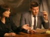 BONES:  Brennan (Emily Deschanel, L) and Booth (David Boreanaz, R) interview suspects after they attend the Gluttony Games, an eating contest, in