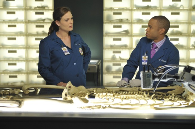 BONES:  Brennan (Emily Deschanel, L) and Jeffersonian intern Dr. Clark Edison (Eugene Byrd, R) examine remains found in boxes at a dead letter office in