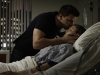 BONES:  Booth (David Boreanaz, L) is worried about Brennan's (Emily Deschanel, R) condition after she is shot while working late at the Jeffersonian lab in the