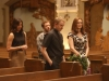 "BONES:  Brennan (Emily Deschanel, R), Angela (Michaela Conlin, L) and Hodgins (TJ Thyne, second from L) rehearse for Brennan's wedding with Father Harrow (guest star David Hornsby, second from R) in the ""The Woman in White"" episode of BONES airing Monday, Oct. 21 (8:00-9:00 PM ET/PT) on FOX.  ©2013 Fox Broadcasting Co.  Cr:  Patrick McElhenney/FOX"