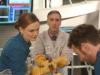 "BONES:  Canadian Forensic podiatrist Dr. Douglas Filmore (guest star Scott Lowell, C) interns with Brennan (Emily Deschanel, L) in the ""The Master in the Slop"" episode of BONES airing Friday, Jan. 24 (8:00-9:00 PM ET/PT) on FOX.  Also pictured:  TJ Thyne (R).  ©2013 Fox Broadcasting Co.  Cr:  Patrick McElhenney/FOX"